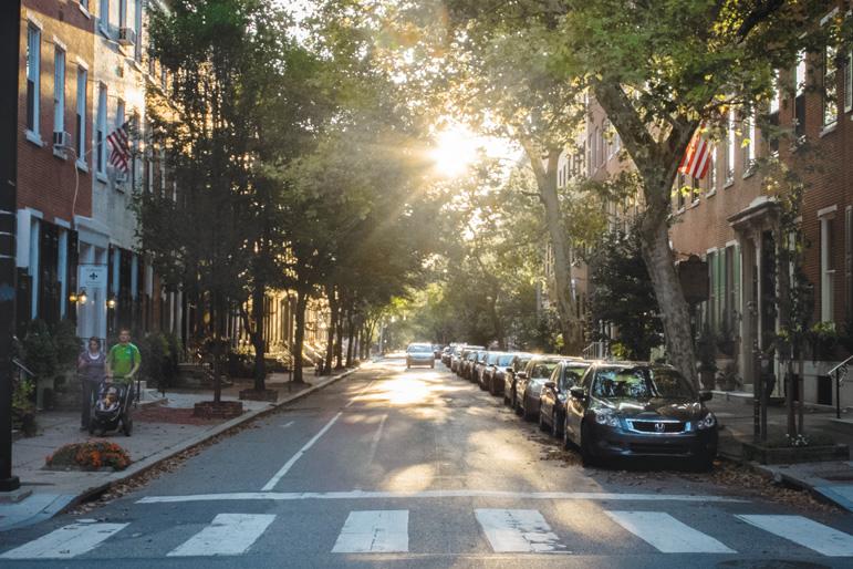 A shady tree-lined street in Philadelphia, PA.